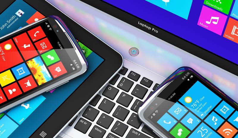 Smartphones, tableta y laptop con íconos de Windows apps